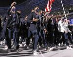 入場行進する米国選手団=23日、国立競技場